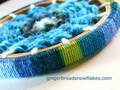 Circular weaving on embroidery hoop #8 by gingerbread_snowflakes, via Flickr.  Like the finished edge of the embroidery loom.  3 projects listed.