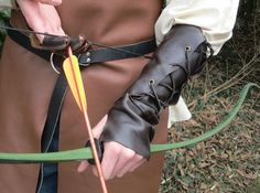 Leather Archery Arm Guard Medieval Ranger Renaissance Fair, $55.  Choose size and color!  Handmade and for sale by FolkOfTheWood on Etsy.