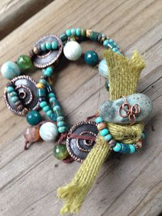 Unique cool bohemian bracelet hand wrapped rock closure with knotted ribbon