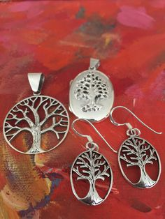 Pendants and earrings with life of tree