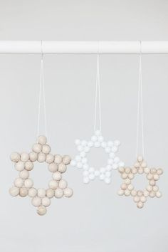 Craft these hanging stars with beads and yarn for easy Hanukkah decor.