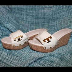 Tory Burch Cream Wedge Sandals These sandals have only been worn once and come from a pet and smoke free home. They have a scuff on the right shoe as pictured. Please message me if you have any questions! Tory Burch Shoes Sandals
