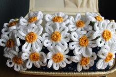 Daisy headbands £13.50 on Etsy. Hand knitted daisies on a lightweight steel headband, perfect for parties/festivals/weddings Copyright Emily Spenceley, Emravel 2017