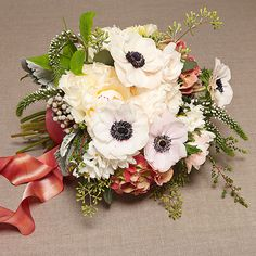 Brides.com: . Wedding Bouquet by Theme: Beach. An earthy beach arrangement made up of anemones, peonies, hydrangeas, silver brunia, veronica, dusty miller, and seeded eucalyptus.  Browse more bouquets for a beach wedding.