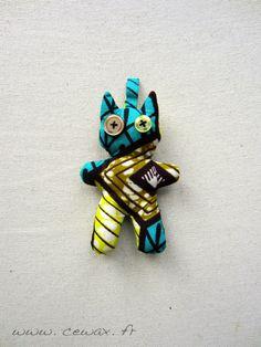 Porte-clés Chat Wax motif africain turquoise et jaune (envoi 0€) : Porte clés par cewax Tous les articles Céwax sont des pièces uniques et sont fabriqués à la main en France. www.cewax.fr