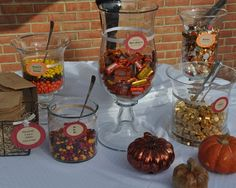 Love that the colors of the candy fit with fall. Would want to add candy corn and the small pumpkins.