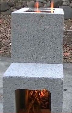 Cinder Block Fire Pit + more projects Rocket Stove Design, Diy Rocket Stove, Rocket Stoves, Fire Pit Backyard, Backyard Patio, Outdoor Patios, Outdoor Rooms, Outdoor Living, Diy Wood Stove
