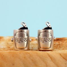 In homage to the humble Baked Bean, and for baked bean lovers everywhere this pair of solid silver cufflinks will make the most unique gift for him!