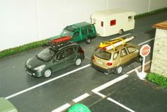 Peugeot 207 SW, Matra Rancho and trailer, Lexus RX300 with surf on the roof. (scale 1/43)