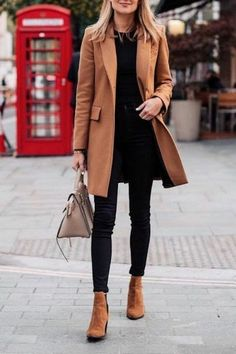Business Casual Outfits For Work In The Office: Camel Coat With Black Jeans | Winter Outfits | Image © Fashion Jackson | These work outfits for women and young professionals are perfect to wear to interviews, for internships and for everyday wear in the office. We've included the best winter work outfits for women. #businesscasualoutfits #workoutfits #professional #outfitsforwork #interviewoutfits #internshipoutfits #officeoutfits #winteroutfits
