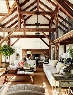 Reclaimed timber beams accent the barnlike common room at Lynn and Sir Evelyn de…