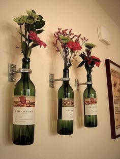 This is unique - flowers in wine bottles mounted on the wall - good for lining a hallway