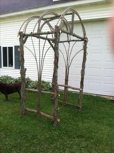 Rustic bent willow wedding arbor