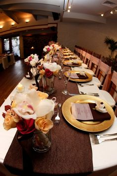 The Willows - Hawaii Venues - Modern chic wedding reception setup with rose centerpieces and gold and red decor