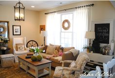 Neutral Family Room with touches of old world charm from Dear Lillie