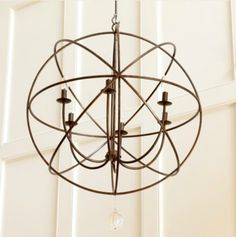 This open wrought iron lamp is made with 6 light fixtures. The circular orb shape is pleasing to the eye and will work in every room.