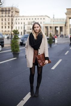 circle scarf + jacket + tights + hair + oversized clutch