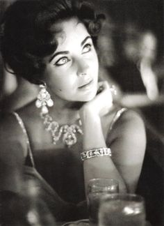 Liz Taylor wearing a creation of Balmain and Cartier jewels, photographed by Richard Avedon. Harper's Bazaar, July 1961