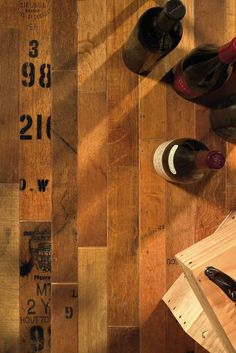 Wine Barrel Wood Flooring exhibits the text markings from both the cooper and the vintner.