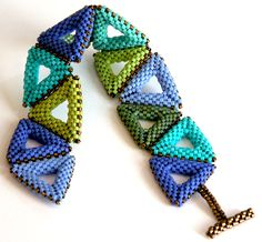 Nita E Kaufman-Last triangle in row acts as part of clasp. Trimmed in brass delica beads. GIFT to my sister Mil.