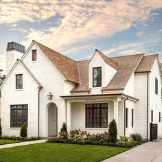 We had so many requests to show more views of this modern Tudor house that we designed and built for Brown Roof Houses, White Brick Houses, White Exterior Houses, Brown Roofs, Exterior Paint Colors For House, Modern Farmhouse Exterior, House Roof, Painted White Brick House, White Stucco House