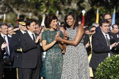 First lady Michelle Obama and Agnese Landini Italian Prime Minister Matteo Renzi, watch during a state arrival ceremony, Tuesday, Oct. 18, 2016, on the South Lawn of the White House in Washington.