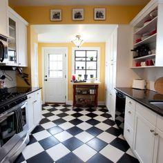 Checkerboard Floor Yellow Walls Red Accents Parisian Decor All The Way
