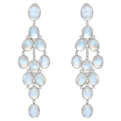 Estate Betteridge Collection Long Moonstone & Diamond Chandelier Earrings, composed of 22 collet-set oval-shaped, cabochon moonstones, accented by 32 circular-cut diamonds / 7,200