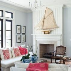 Love light room with pale blue walls and pale red accents with Delf orchid pots.