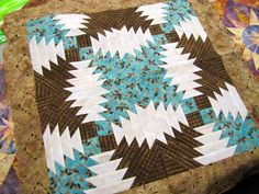 Pineapple Quilt blocks - love the colors and positioning.