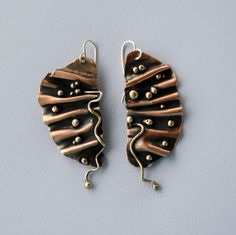 Earrings | Cyndie Smith. 'Ruffled'  Sterling silver, copper and brass.