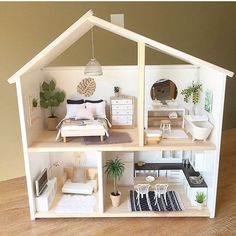 IKEA FlISAT. $29.99 dollhouse wall shelf.
