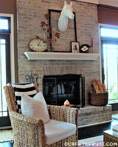 whitewash fireplace, white mantel, woven basket for wood