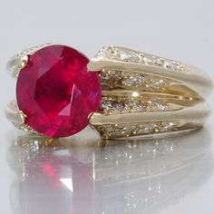 Jose Hess Ruby Ring... I so want a ruby in gold with chocolate diamonds :)