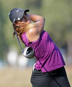 Cheyenne Woods watches her tee shot on the second hole during the first round of the U.S. Women's Open golf tournament in Pinehurst, N.C., Thursday, June 19, 2014. (AP Photo/John Bazemore) ▼19Jun2014AP|Lewis holds 1-shot lead over Wie in Women's Open http://bigstory.ap.org/article/lewis-takes-early-lead-pinehurst-67 #US_Womens_Open_Championship_2014