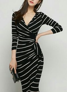 Love the wrap style dress and emphasis on the waist. Not too crazy about the print.