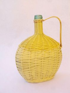 Viresa retro bottle covered with woven scoubidou (vinyl), gold handle, wooden base - vintage item from the 1960s