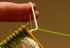 When adding a new color, never knot! Instead, join new yarns neatly and invisibly at the beginning of a row. Knots have a way of coming untied and working themselves to the front of your work when you least expect it. We recommend this method: Place the needle into the stitch, dropping the old yarn and picking up the new yarn, leaving a 4-inch tail to be woven in.