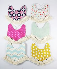 Darling reversible boho fringe bibs in 10 different styles. Each bib is beautifully handmade and is sure to compliment any outfit. The unique reversible design is like getting two bibs in one!Perfect for gifting or for your own little one...this bib will be a keepsake for years to come.The bibs have a tie closure so you can adjust it as needed to fit your child. Perfect for infants and toddlers!