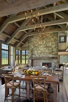 Gorgeous fireplace, beams look worn, LOTS of windows, right off eat-in kitchen