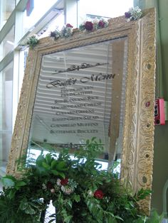 Antique mirror with buffet menu in vinyl letters. Flowers by Legardia's Flowers & Gifts, (702) 366-0026. Vinyl lettering by Sin City Signs (702) 889-6223.