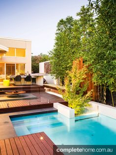 Garden symphony: Asian-inspired twist The warm, natural tones of the timber and the rich greens of the foliage are offset by the