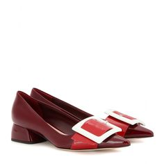 Miu Miu - Patent leather pumps - With an oversized white buckle detail, these Miu Miu pumps are a stylish way to bring a vintage touch to your ensembles. Two tones of glossy red patent leather and a pointed toe elevate the retro-inspired pair. Stay true to the brand's feminine aesthetic and style yours with a woollen miniskirt. seen @ www.mytheresa.com