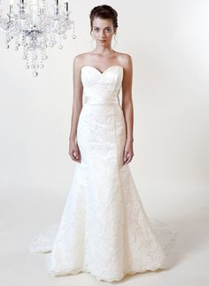 Victoria style 9141  A romantic Alencon Lace gown with sweetheart neckline silk sash at the natural waistline. Shown in cream pearl. Also available in white and pearl.