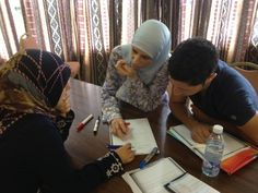 Masar training on the peer education approach, participants engaging in interactive training techniques such as group work discussing issues related to becoming effective peer educators in their respective communities.