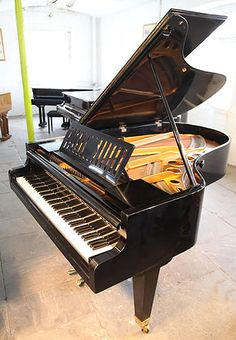 A 1935, Bosendorfer grand piano with a polished, black case and tapered, square legs at Besbrode Pianos