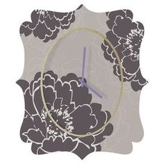 """Wall clock with a floral motif by artist Caroline Okun for DENY Designs.  Product: ClockConstruction Material: Aluminum and engineered woodColor: Gray and purpleFeatures:   Part of the Caroline Okun CollectionUV resistant coatingIncludes wire mount with picture hanger and one C battery  Made in the USA Dimensions: Small: 14.5"""" H x 19.5"""" W x 1.5"""" DMedium: 21.7"""" H x 29.2"""" W x 1.5"""" DLarge: 30.6"""" H x 36"""" W x 1.5"""" D"""