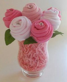 Warm fuzzy socks, rolled up & pin, pink shredded paper & a glass vase, this would be great to pair with a bouquet of flowers with small gift card attached.  Or add a $ amount inside each sock.  G;)