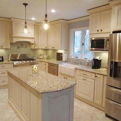 light granite; cream cabinets and hood over range