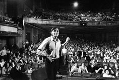 Rock promoter Bill Graham onstage w. audience visible, at Fillmore East. circa 1970